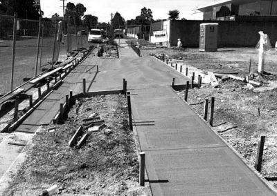 Kerbs & gutters built by Soligo Concrete Constructions Sydney NSW Australia. Kerbs & gutters are used to create an edge, raised pavement walkways or foodpaths, road medians and gutters.